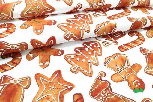 Weißer Dekostoff mit verzierten Weihnachts-Lebkuchen bedruckt